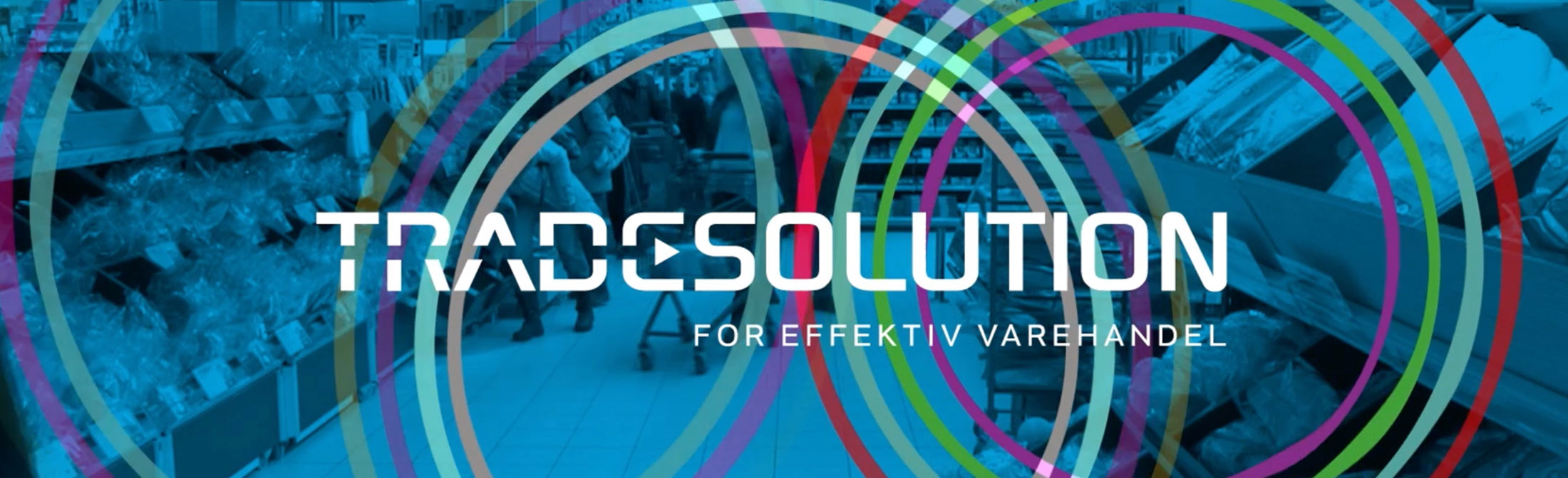 Matbutikk med blåskjær, fargerike ringer og Tradesolution logo. Grafikk.