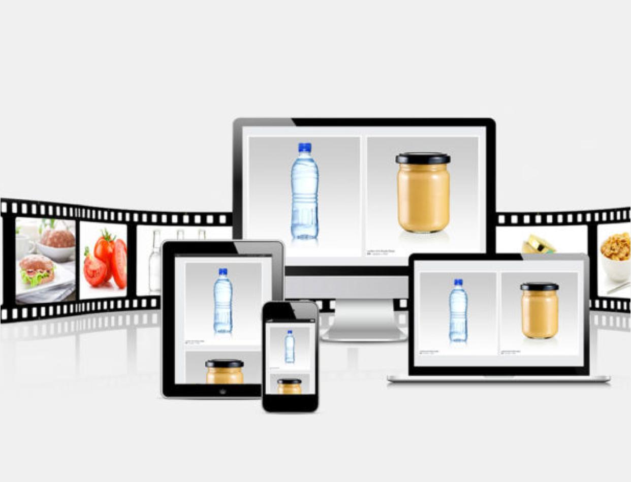 Filmrull og PC med dagligvarer som brød, vann og honning. Grafikk.