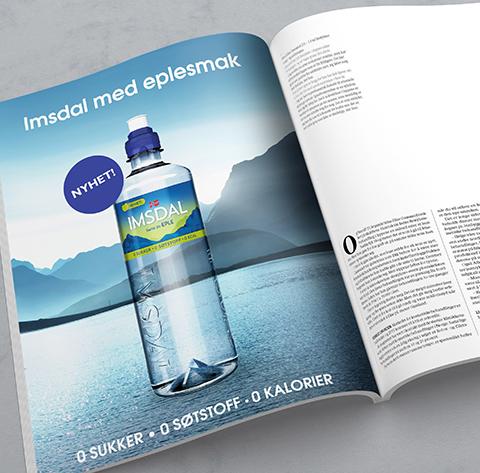 Magasin med eksempel på annonse for Imsdal vann med fjell og vann. Grafikk.